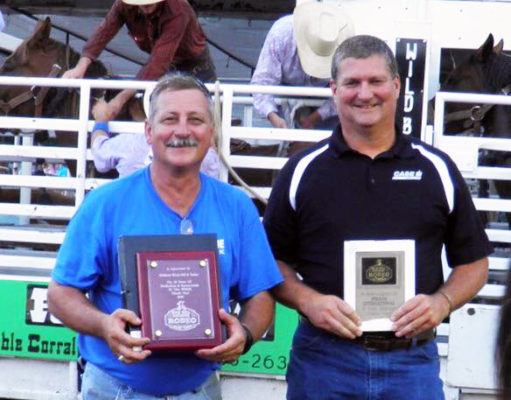 The Wild Bill Hickok Rodeo committee was pleased to honor the following sponsors at Friday night's performance: (left to right) Mark Picking-Abilene Rent-All - 20 years; Kevin Mortimer-Straub International - 10 years.