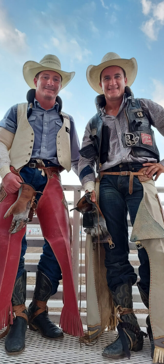Bareback riders and friends Bill Tutor (on the left) and Jake Brown pose together after winning the Abilene, Kan. rodeo. Each man scored 85 points to tie for first at the rodeo, which celebrated its 75th anniversary this year.